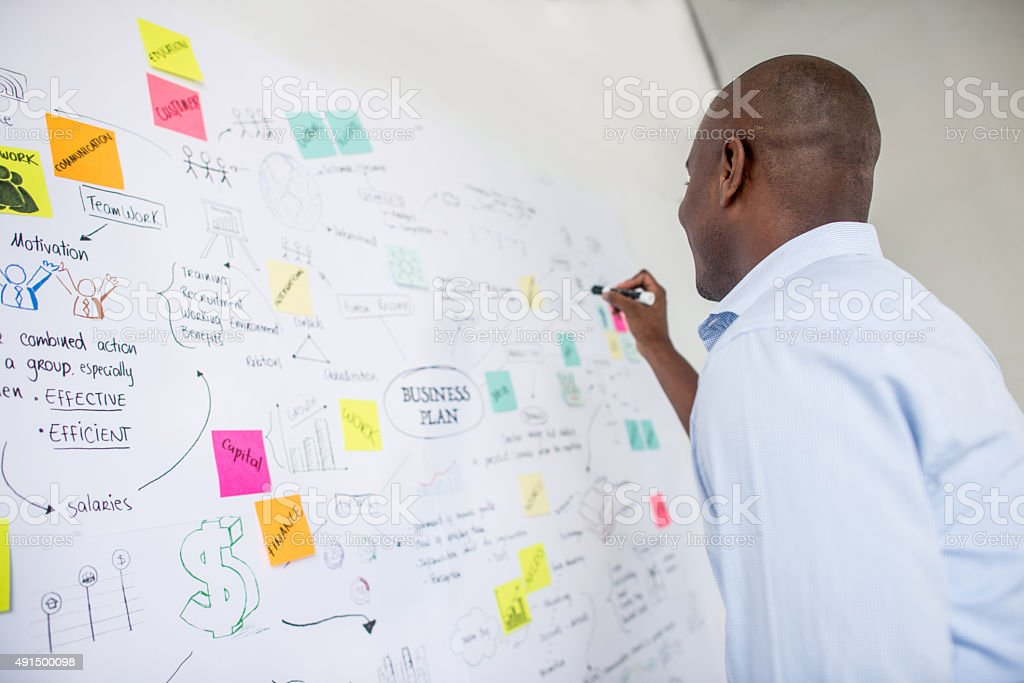 African American business man drawing a plan stock photo