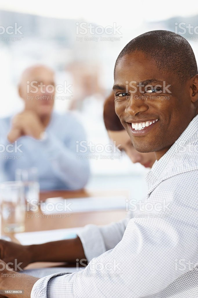 African American business man smiling in a meeting royalty-free stock photo