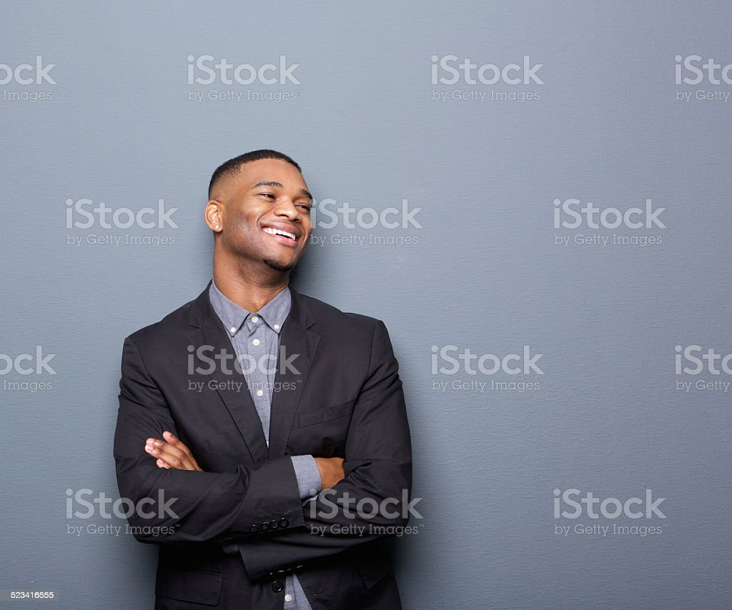 African american business man smiling with arms crossed stock photo