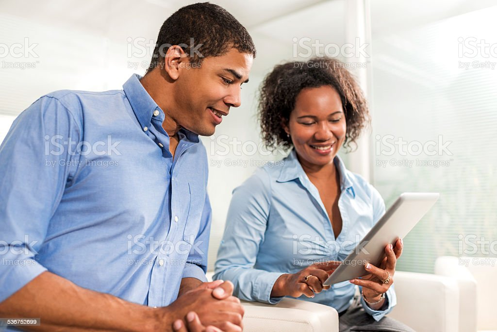 African American business people using digital tablet. stock photo