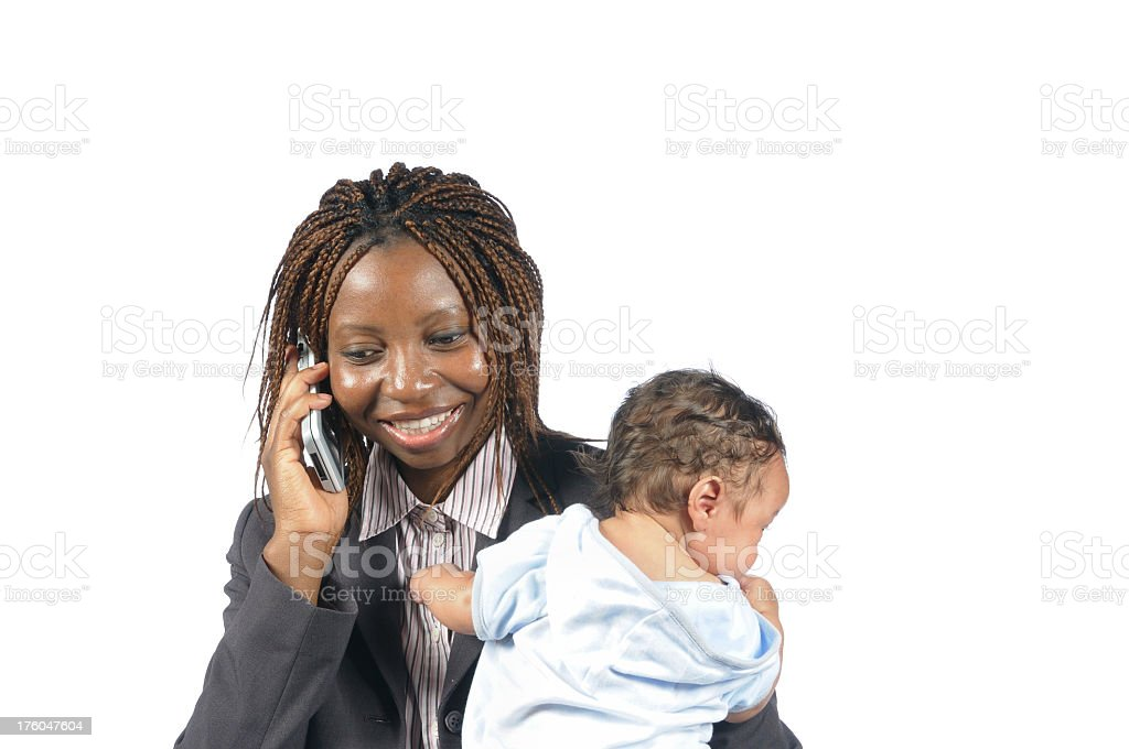 African American Business Woman Smiling on the Phone holding Baby royalty-free stock photo
