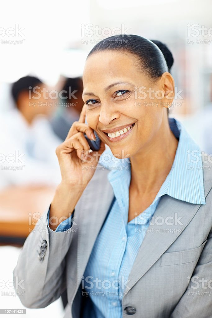 African American business woman talking on cellphone royalty-free stock photo