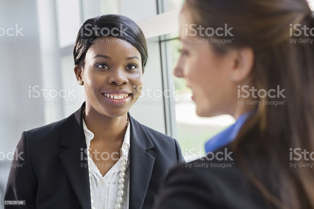 African american business woman talking to a female coworker royalty-free stock photo