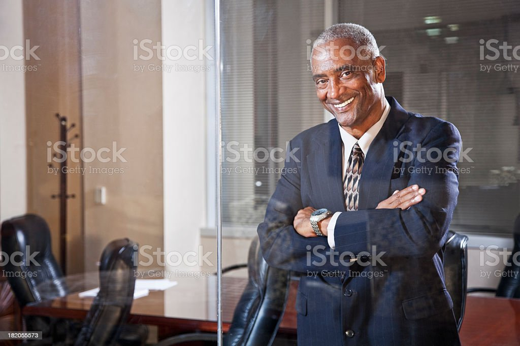 African American businessman in boardroom stock photo