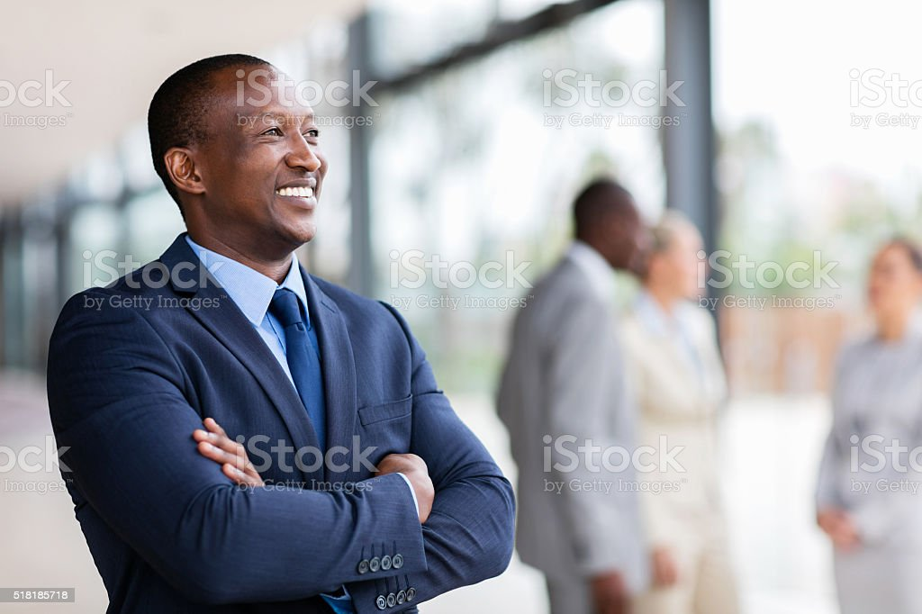 african american businessman looking away stock photo