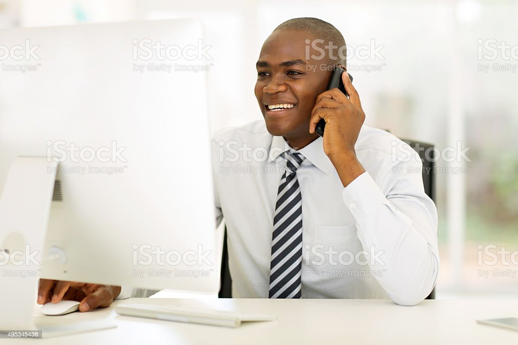 african american businessman making phone call stock photo
