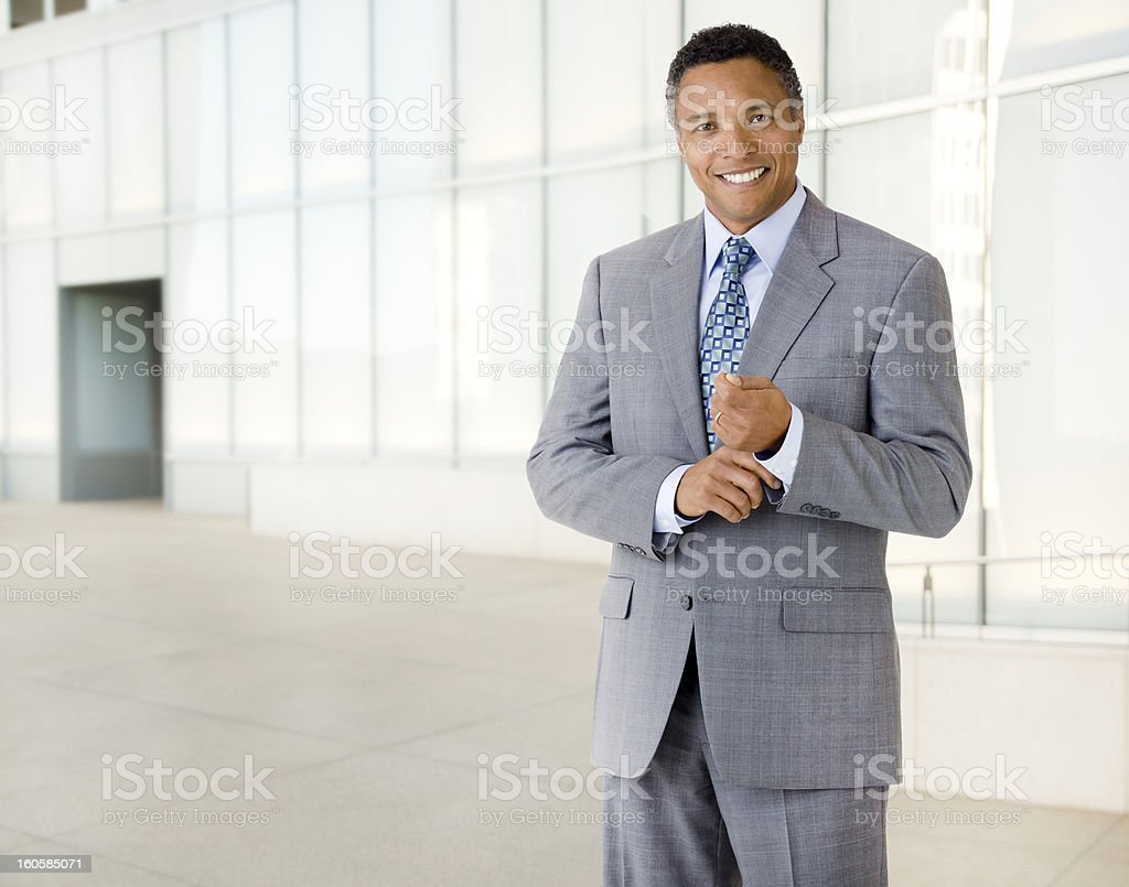 African American Businessman Next to Modern Office Building stock photo
