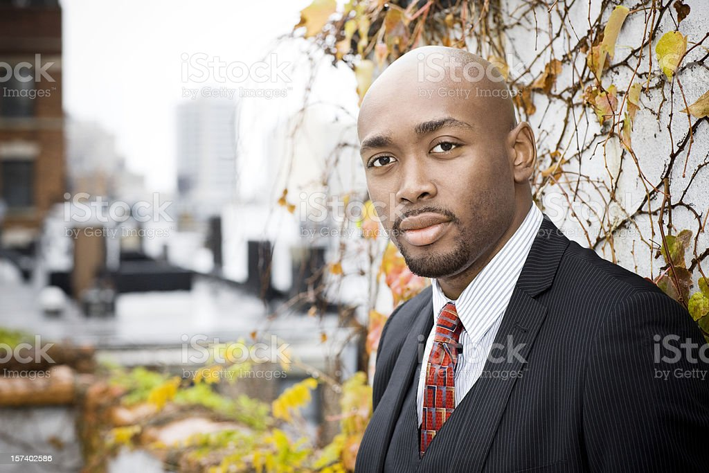 African American Businessman Portrait on City Rooftop, Copy Space stock photo