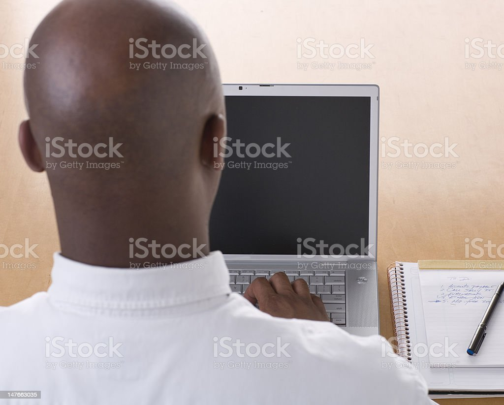 African American Businessman working on laptop stock photo
