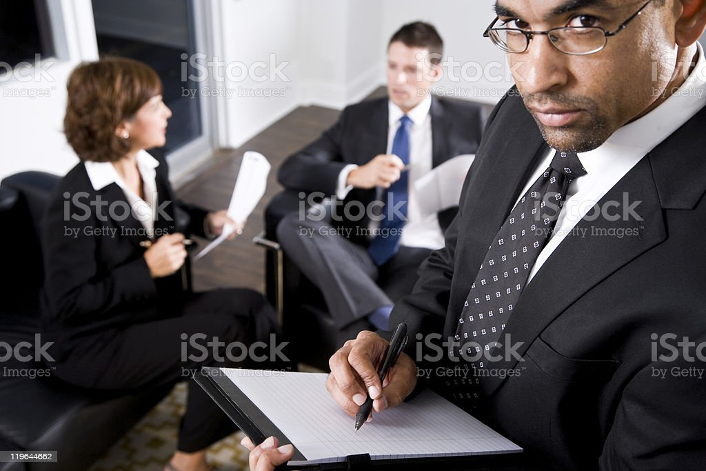African American businessman writing on notepad royalty-free stock photo