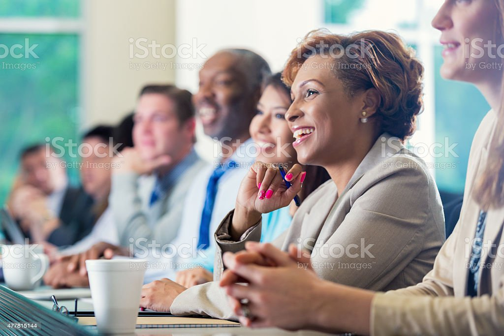 African American businesswoman attending seminar or job training business conference stock photo