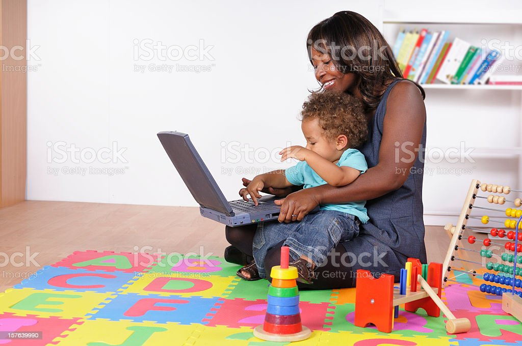 African American Businesswoman Incorporating Work And Childcare stock photo