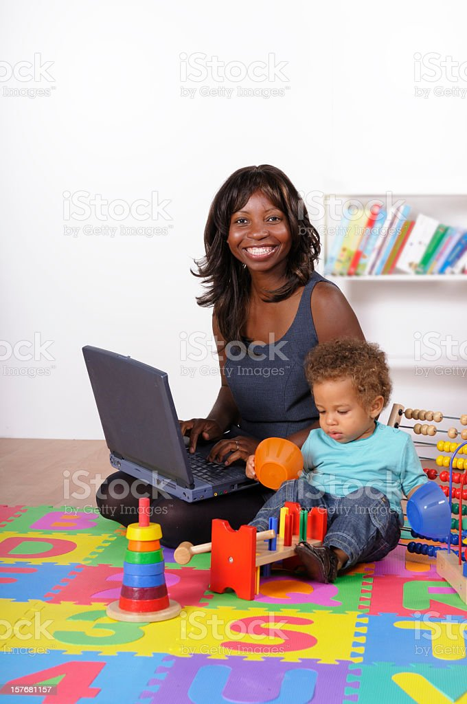 African American Businesswoman Smiling While Data Processing stock photo