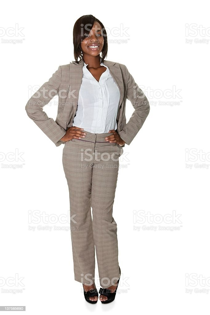 African American businesswoman standing confidently on white royalty-free stock photo