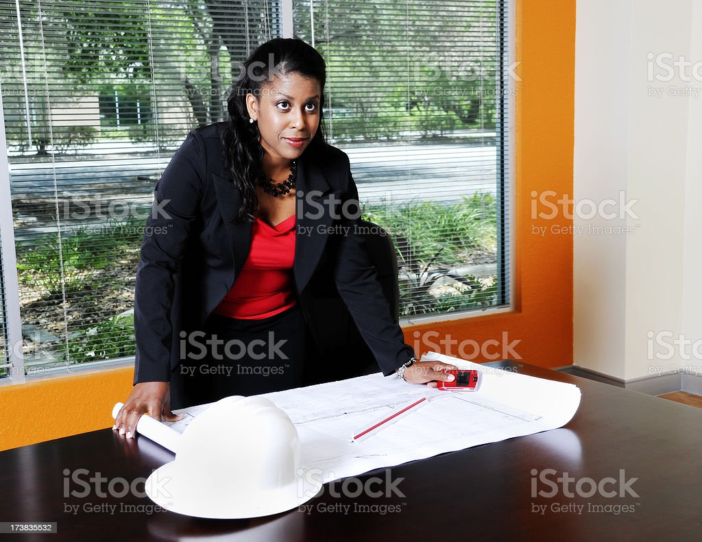 African American Businesswoman With Contruction Plans In the Office royalty-free stock photo