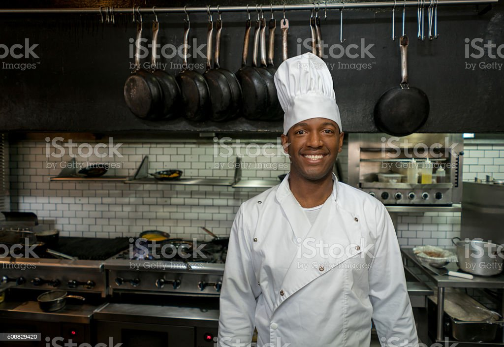 African American chef working at a restaurant stock photo