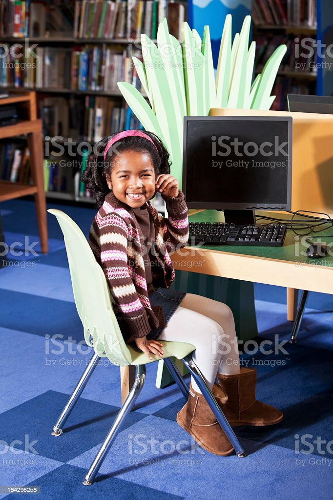 African American child at library computer stock photo