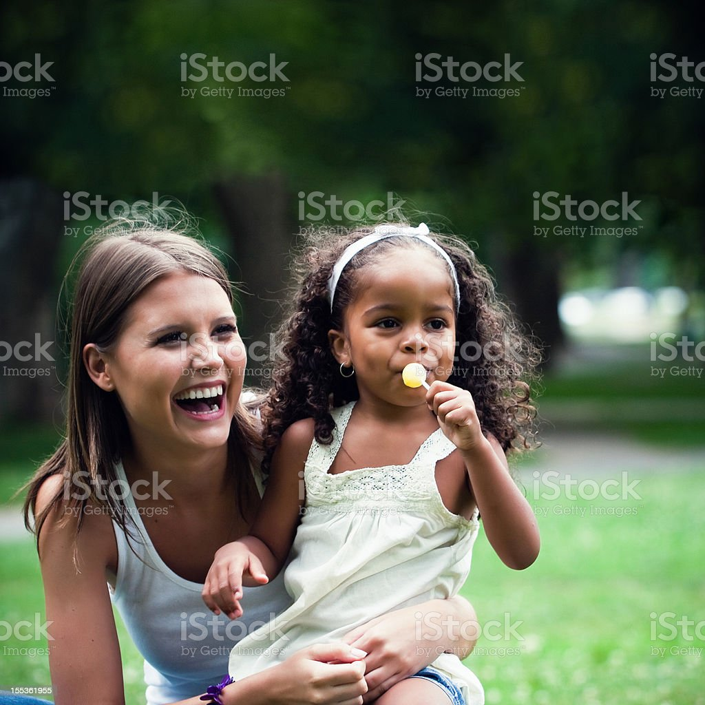 African american child together a white girl in the park royalty-free stock photo