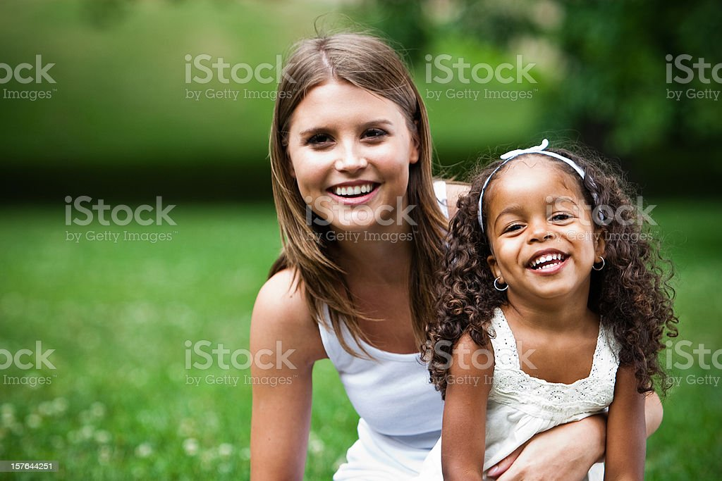 African american child together a white girl in the park stock photo