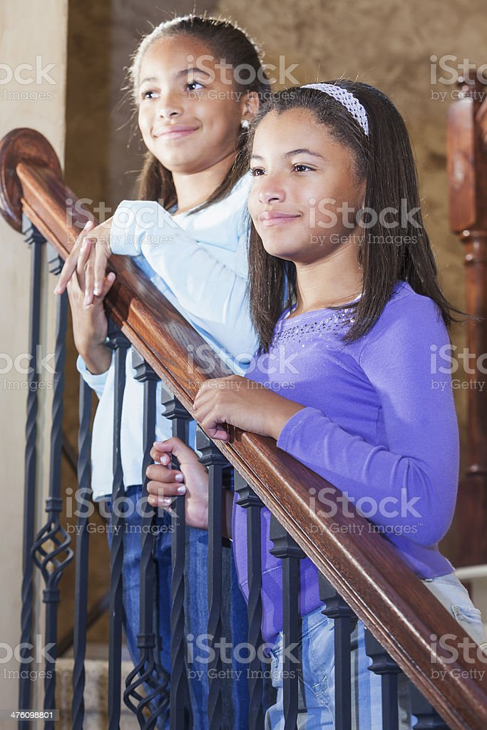 African American children at home standing on stairs stock photo