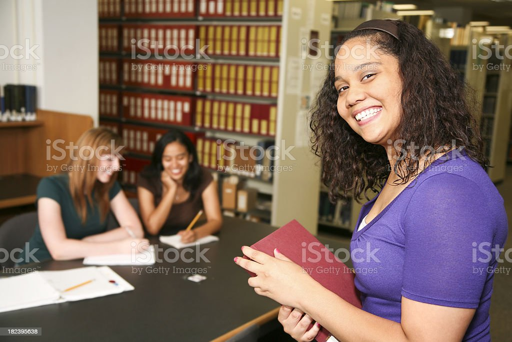 African American College Student in Library with other Students royalty-free stock photo