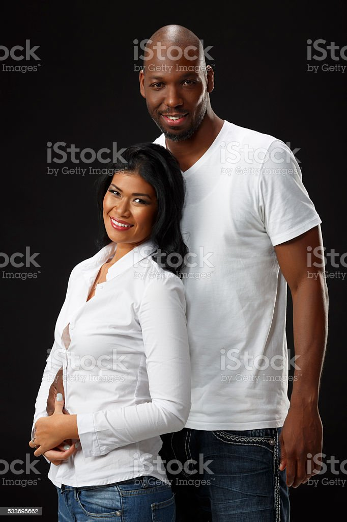 African American Couple Hugging and Smiling stock photo