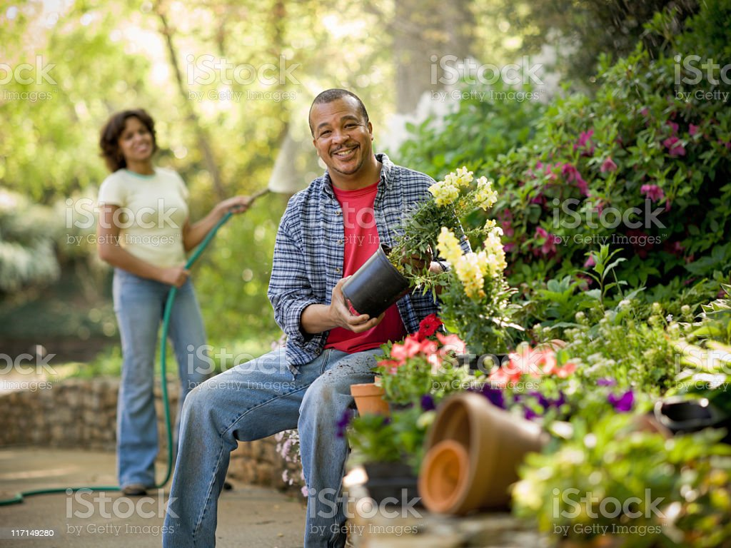 African American Couple in Flower Garden stock photo