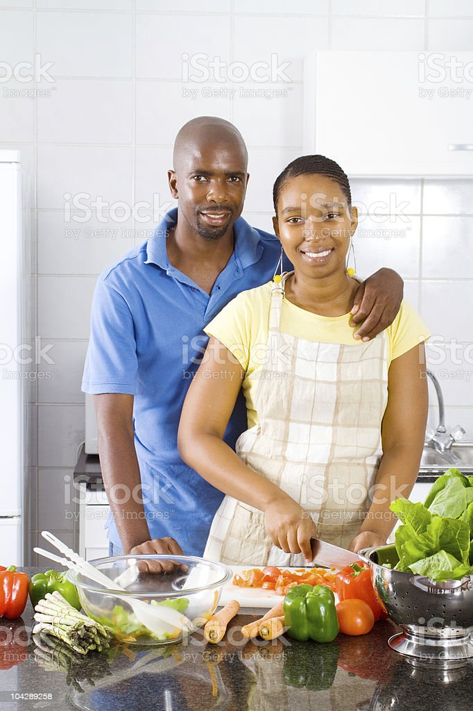 african american couple in kitchen royalty-free stock photo