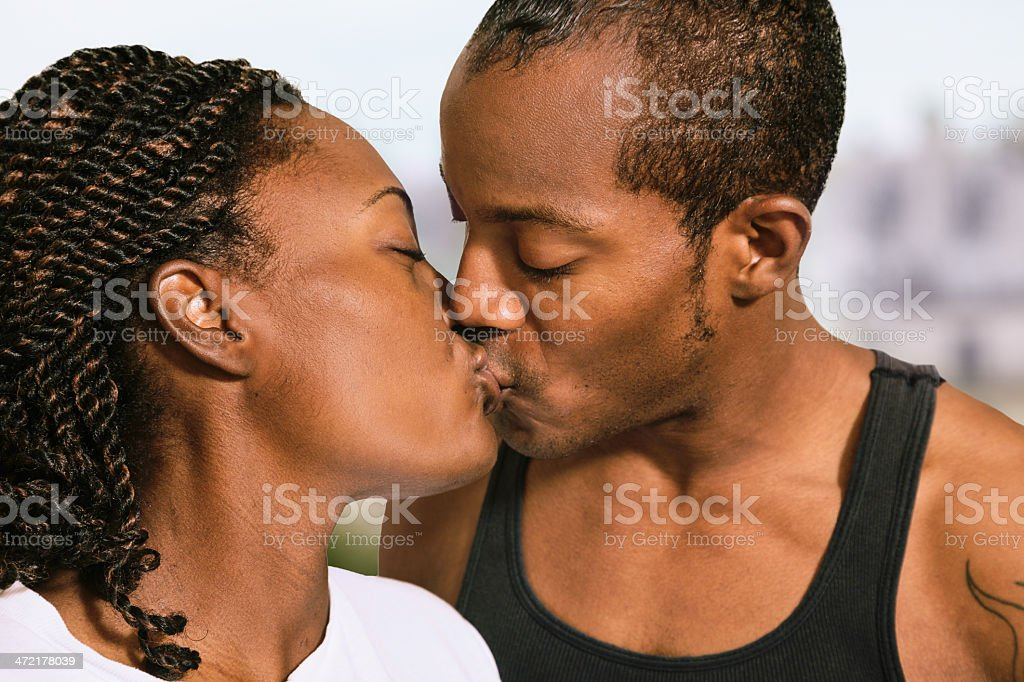 African American couple kissing close-up royalty-free stock photo