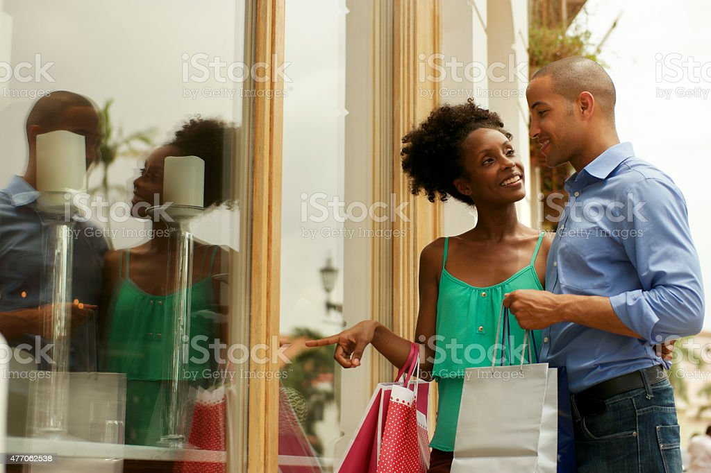 African American Couple Look Shop Window In Panama City stock photo