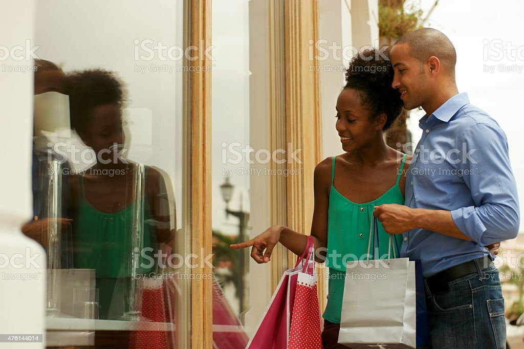 African American Couple Looking Shop Window In Panama City stock photo