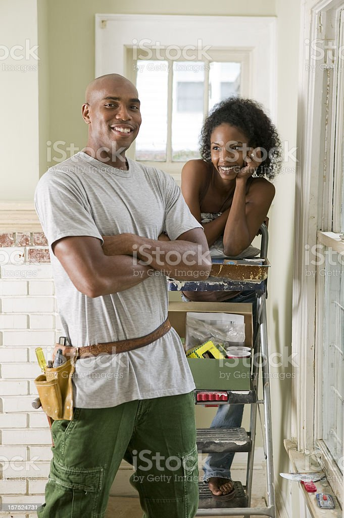 African American Couple renovating their home. stock photo
