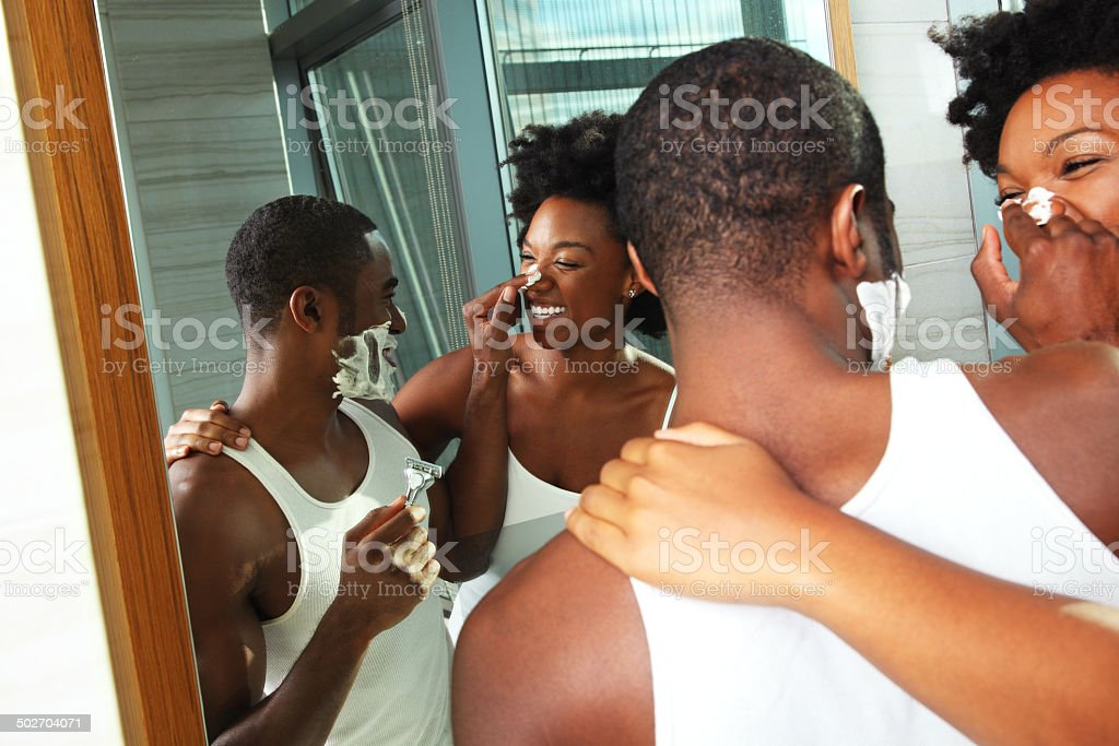 African American Couple Shaving in the Bathroom stock photo