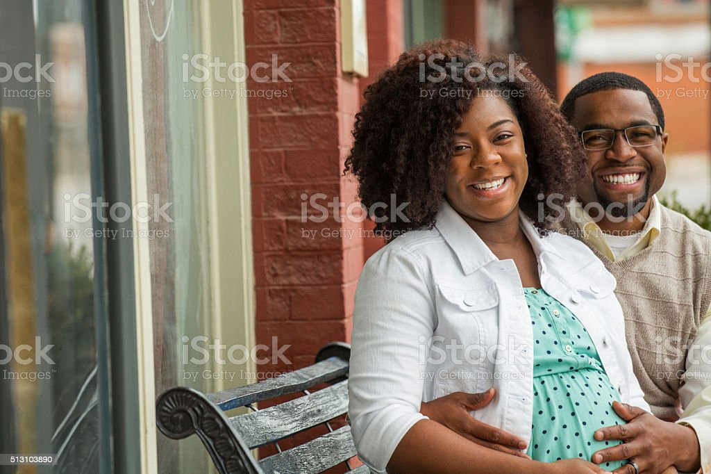 African American Couple talking stock photo