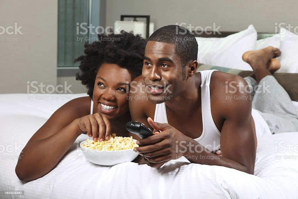 African American Couple Watching a Movie at Home royalty-free stock photo