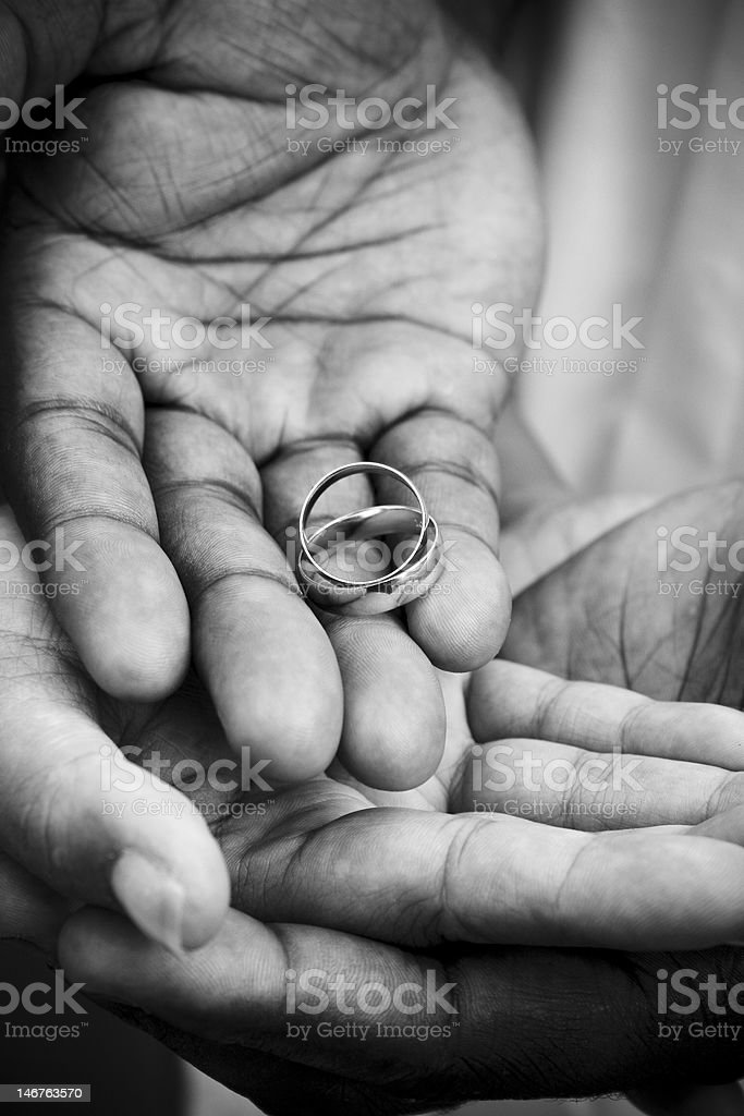 African American Couple's Hands with Wedding Rings stock photo