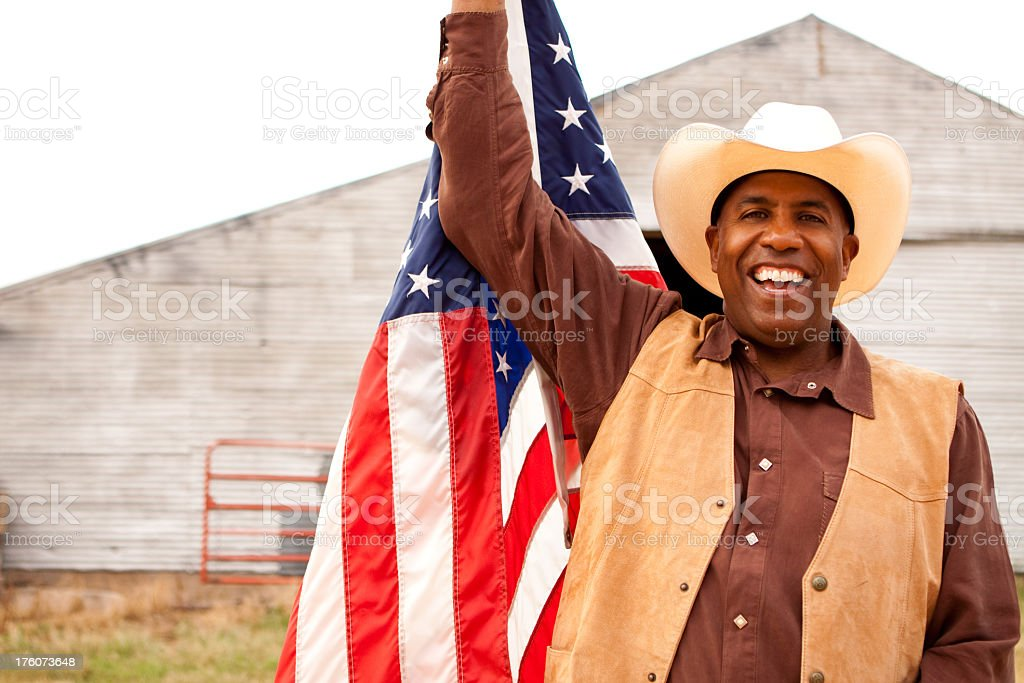 African American Cowboy with a Flag royalty-free stock photo