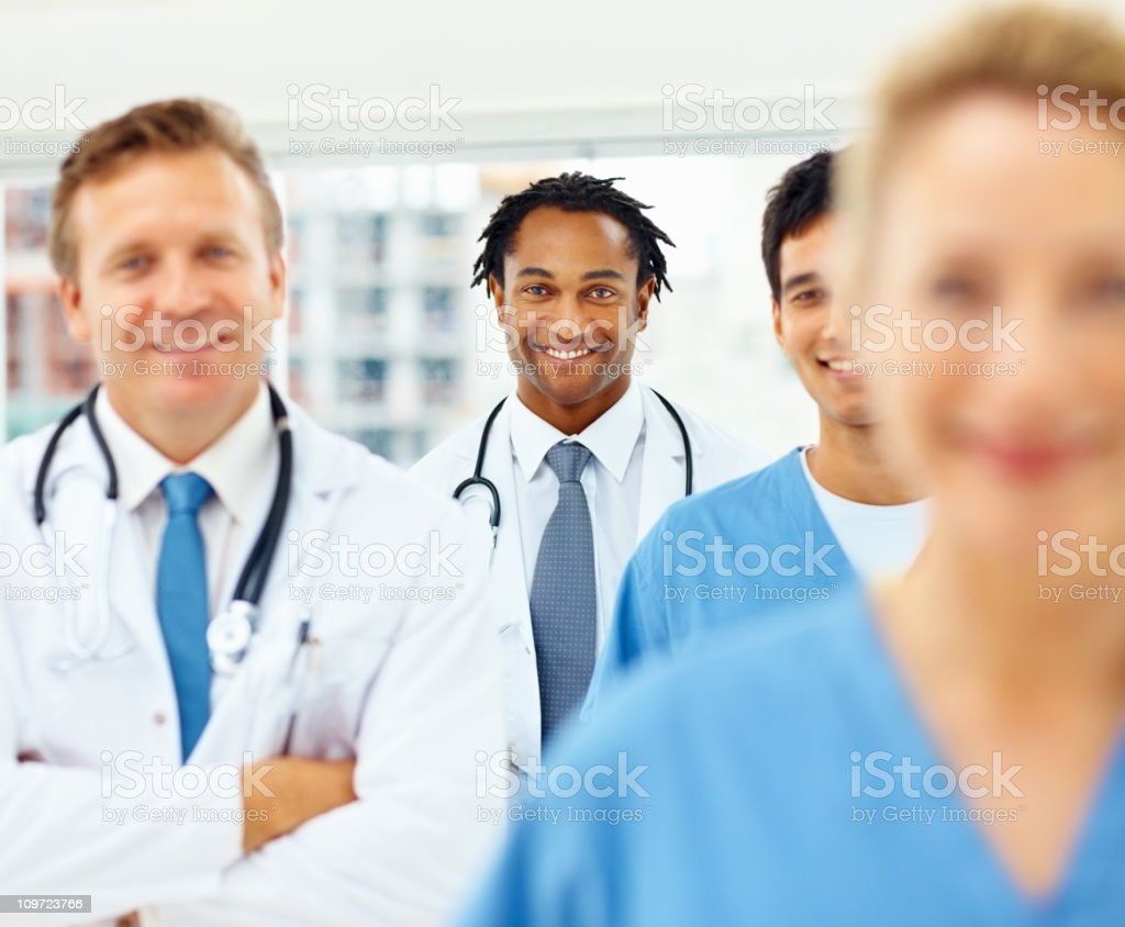 African American doctor smiling with colleagues royalty-free stock photo