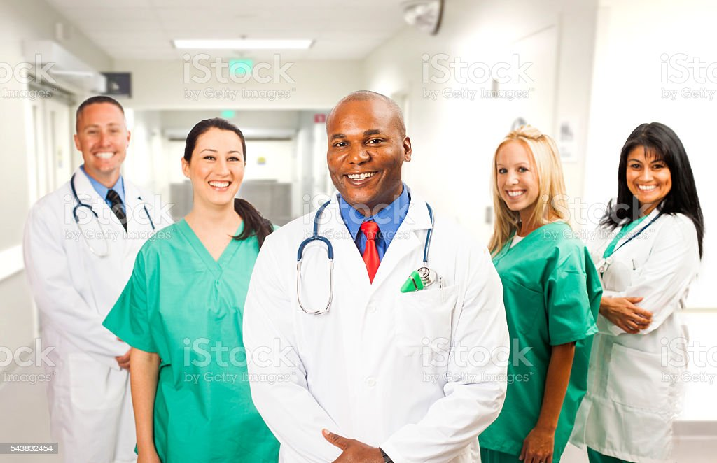 African American Doctor with his Medical Team stock photo