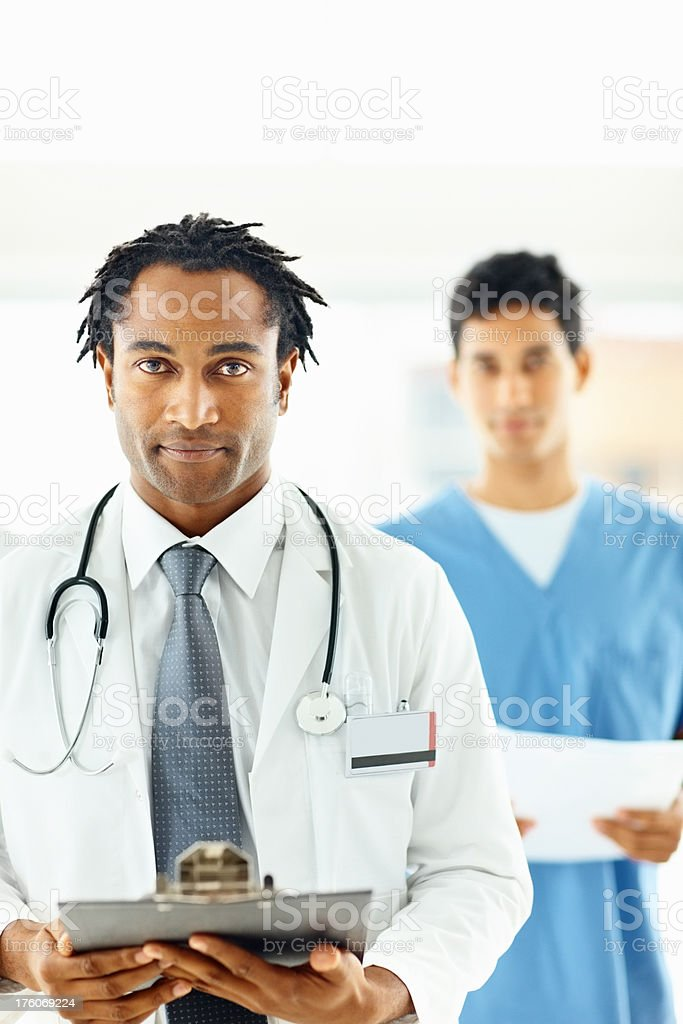 African American doctor with male nurse at the background royalty-free stock photo
