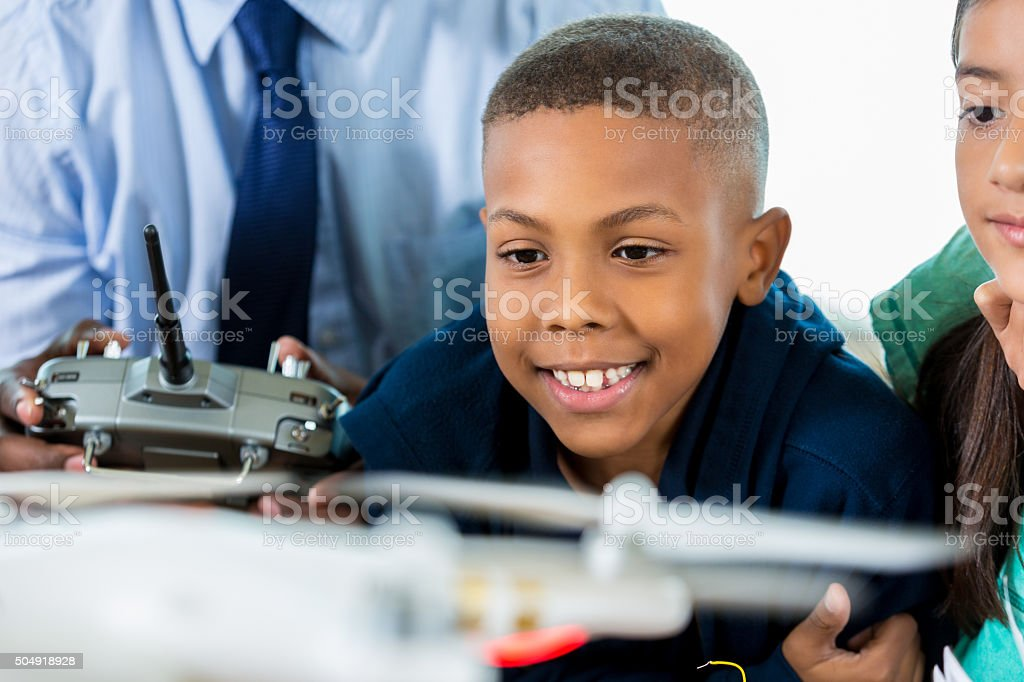 African American elementary student learning about drones in science class stock photo