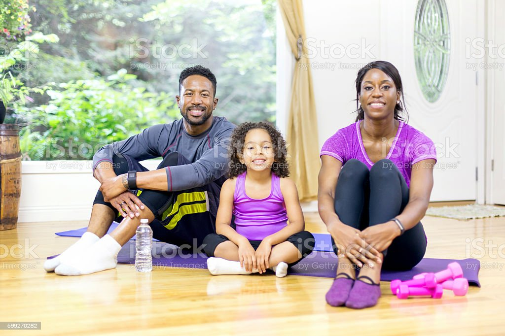 African american family after a home fitness session stock photo