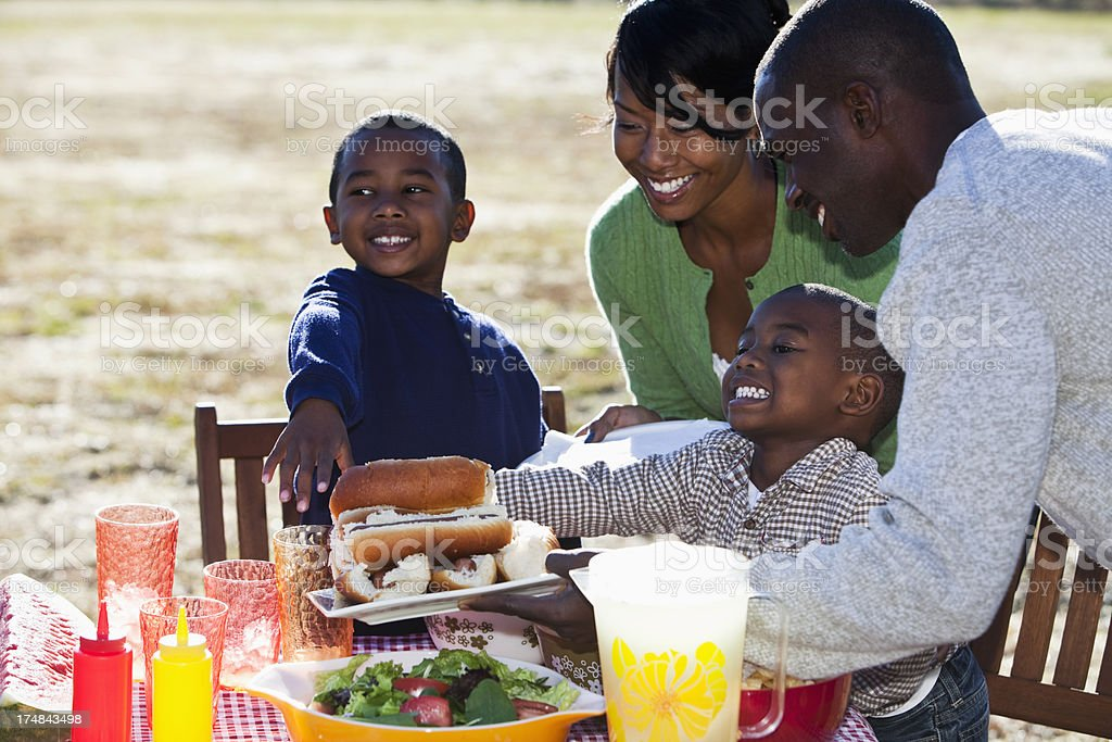 African American family enjoying cookout stock photo