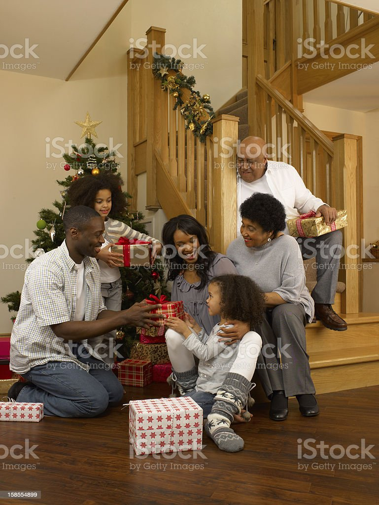 African American family exchanging Christmas gifts royalty-free stock photo