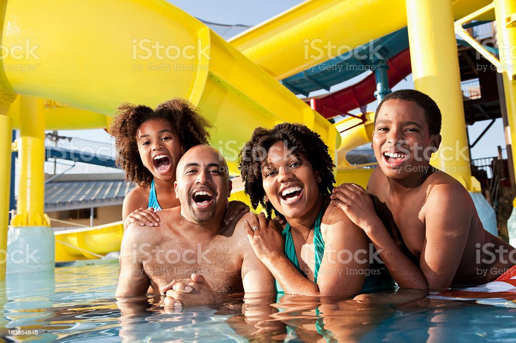African American family having fun at water park royalty-free stock photo