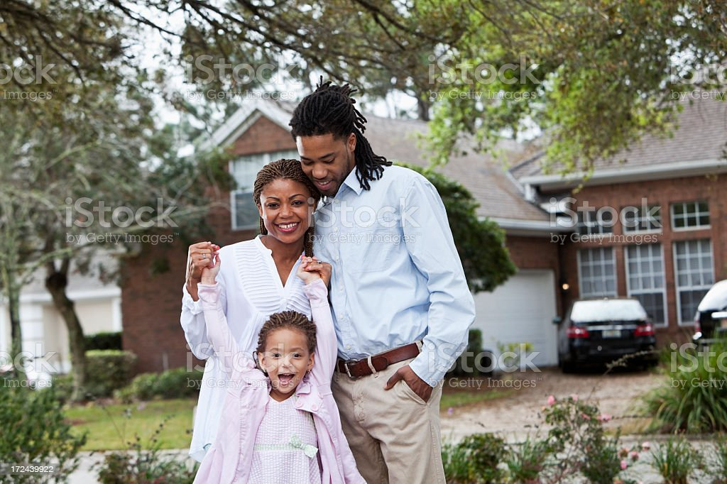African American family in front of house stock photo