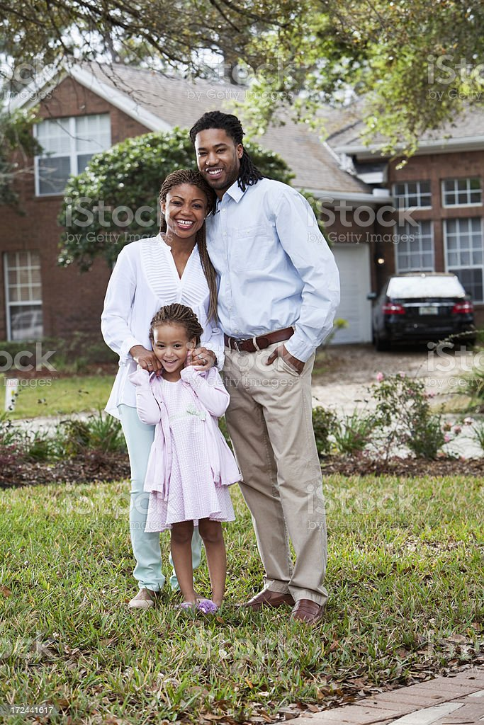 African American family in front of house royalty-free stock photo