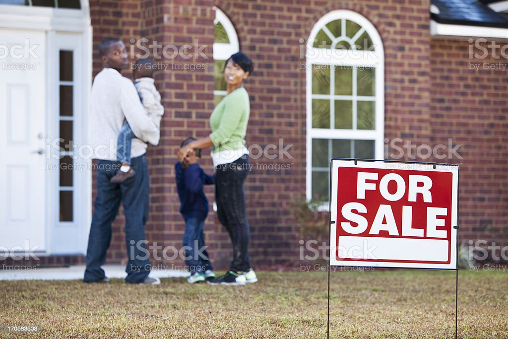 African American family looking at house for sale royalty-free stock photo