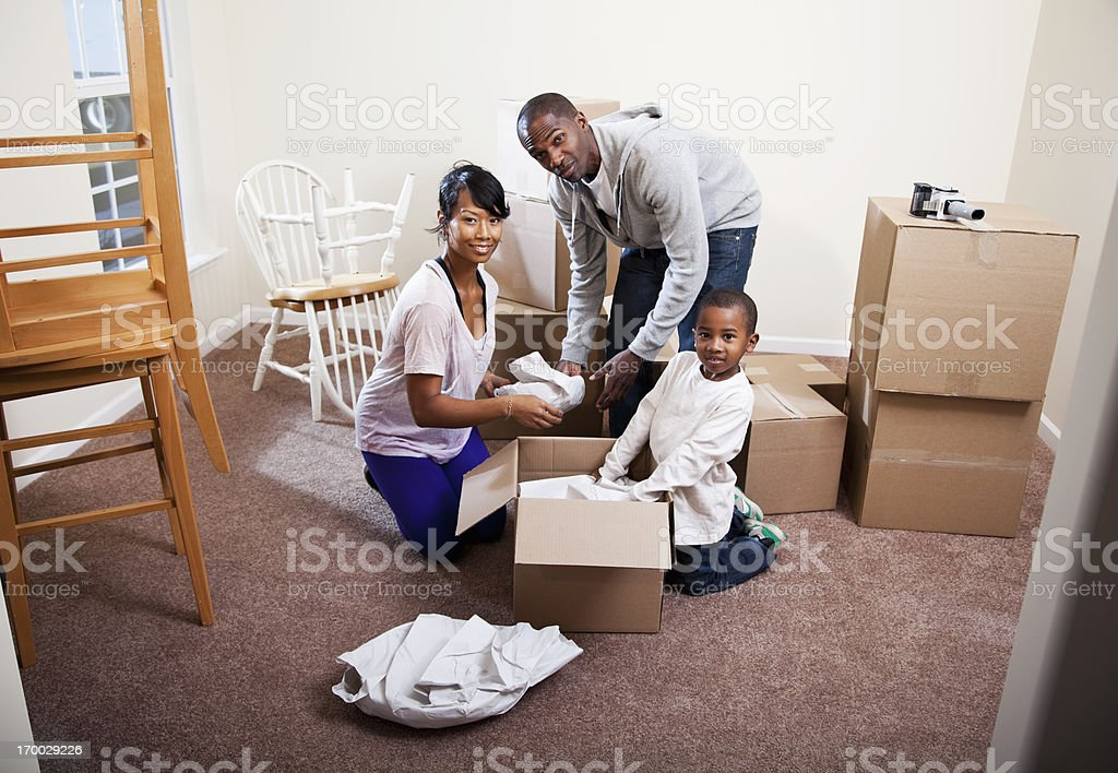 African American family moving house stock photo