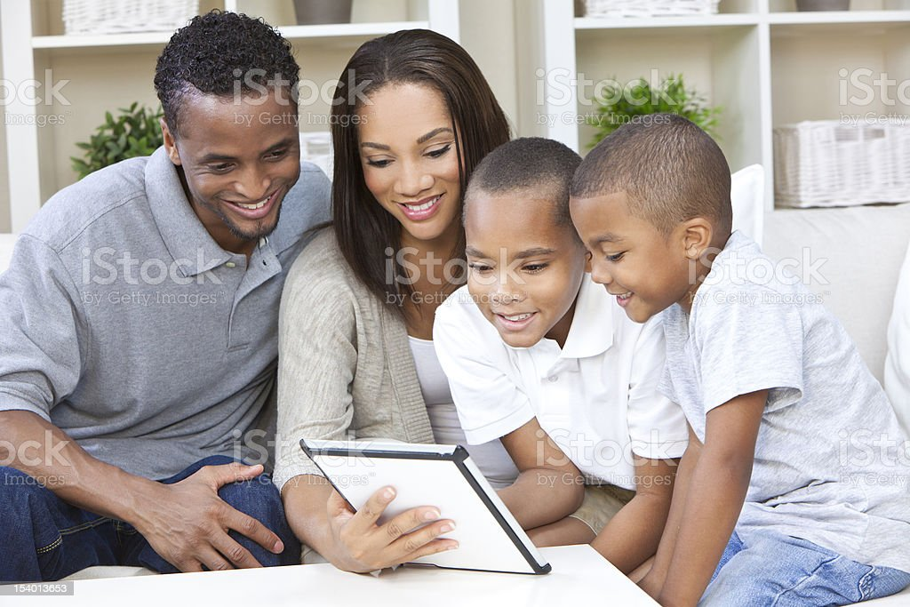 African American family using a tablet computer royalty-free stock photo